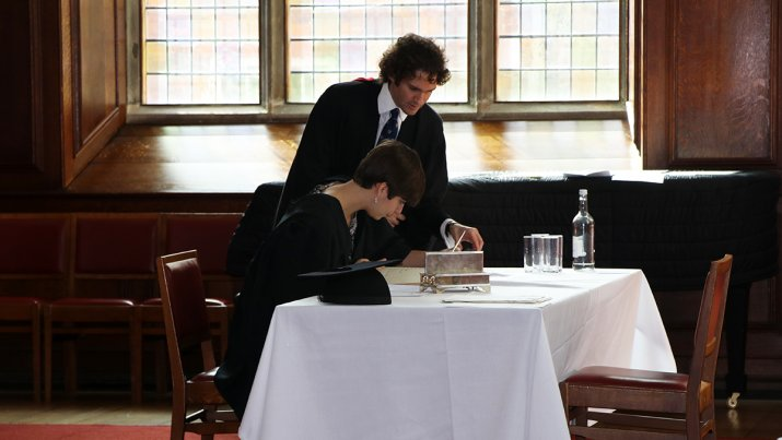 Signing the Matriculation book
