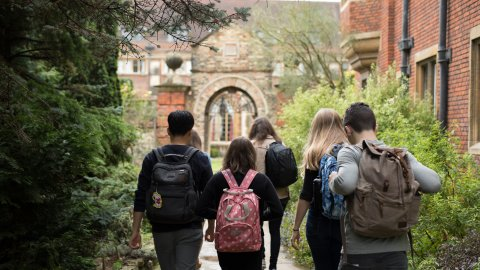 Students walking on Pembroke grounds on their way to lecture