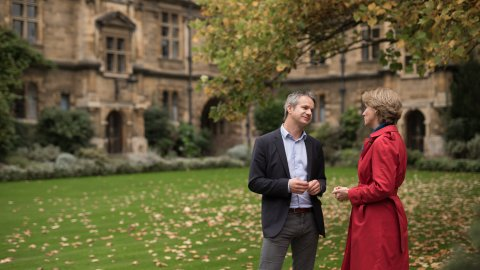 Slideshow image of two lecturers talking on the Pembroke grounds