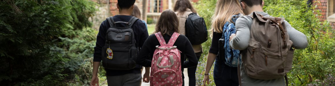 Image of students carrying bags exploring Pembroke's grounds.